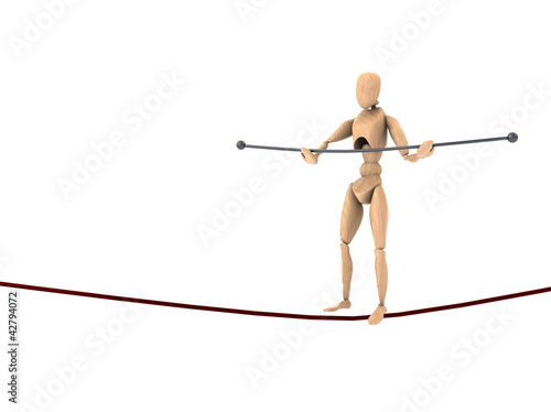 wooden dummy balancing on the rope