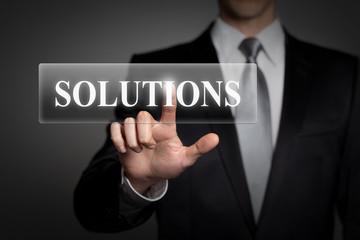 businessman pressing virtual button - solutions
