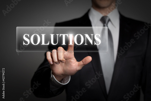 businessman pressing virtual button - solutions