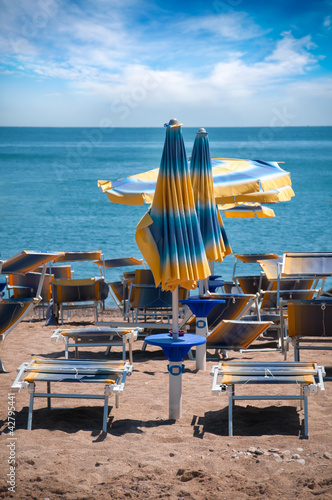 beautiful beach  with beach beds and umbrella