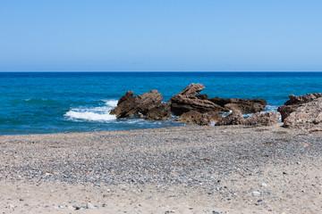 Beautiful small pebble beach on the sea coast