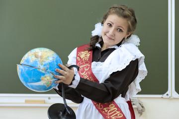 The graduate of school holds the spoilt globe