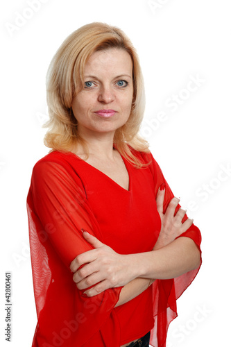 serious woman in a red blouse