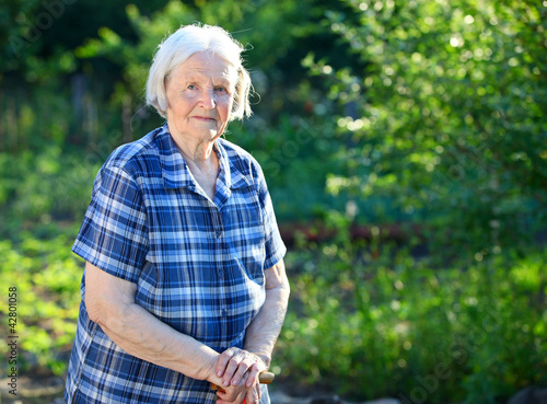 Portrait of an elderly woman outdoors