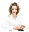 Attractive young woman counting money