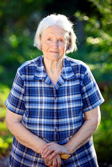Portrait of a smiling elderly woman outdoors