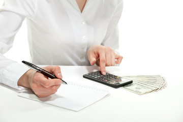 Female accountant calculating revenues and costs