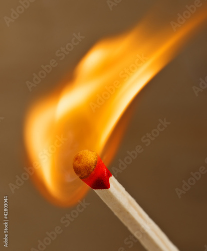 head of a match starting to burn