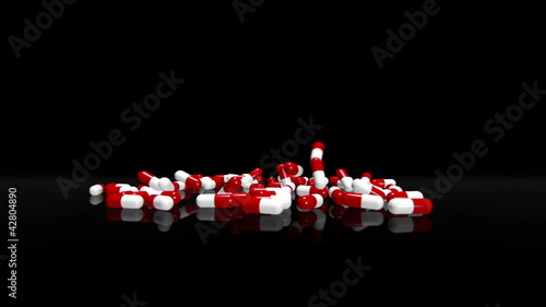 Red White Pills Falling on Black Background