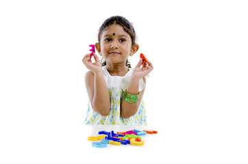 indian baby learning with alphabet blocks
