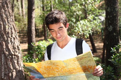 portrait of a young man with map