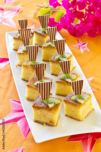 Square mini sponge cakes .