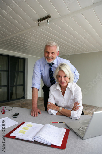 Senior business couple