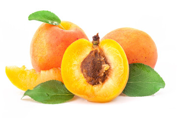 Apricot fruits and slices with leaves, isolated on white