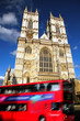 Westminster Abbey cathedral with city bus in London, UK