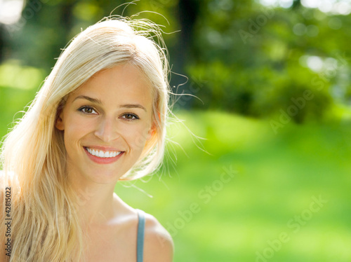 Smiling young beautiful woman, outdoors