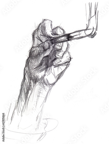 A hand draws a brush, pencil. © artpavlin
