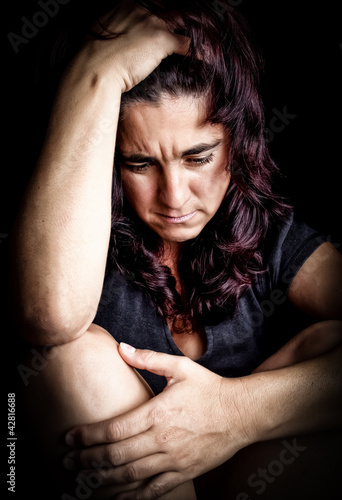 Hispanic woman suffering from a strong depression