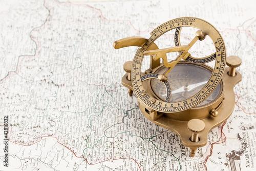 Leinwandbild Motiv Old nautical sundial compass and map