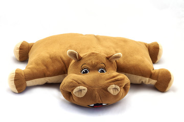 pillow on the sofa. toy hippo