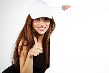 beautiful smiling girl holding a blank billboard.