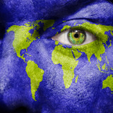 World map painted on face to show earth support