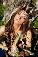 Sensual wild woman in wild clothes posing. Tribe. Retro style