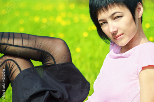 funny woman is lying on the grass