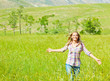 Young happy woman walking on wheat field