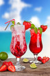 Strawberry cocktails with blur beach on background