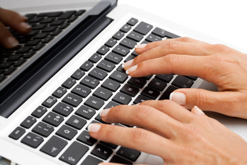 Macro close up of female hands on keyboard.