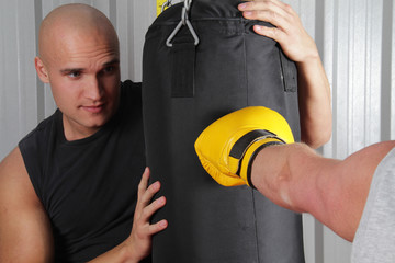 Boxer Hitting The Punch Bag