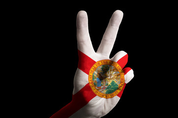 florida us state flag two finger up gesture for victory and winn