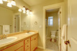 Classic two sink bathroom in beige color.