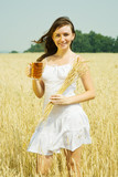 Girl  with beer and wheat ear