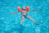 A boy swims in the pool
