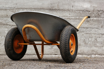 orange farmer's two wheelbarrow