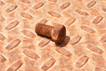 Rusty metal plate and bolt