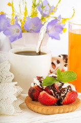 Strawberry with a mint and chocolate, cup of coffee