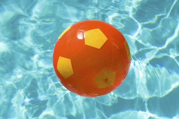 Beach ball over water