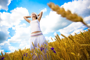 woman with outstretched arms is enjoys summer day