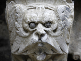 Sculpted stone mask figure on St. Stephen's Cathedral in Vienna