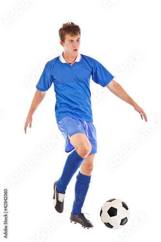 Footballer with soccer ball