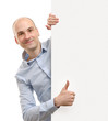 man with blank banner showing thumbs up gesture