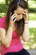 Sad woman receiving bad news