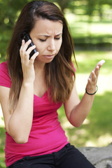 Upset woman talking on the phone