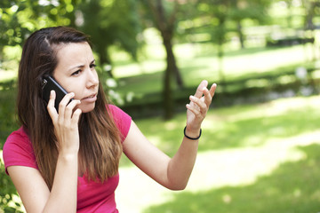 Irritable young woman on the phone