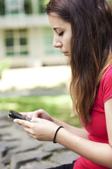 Young woman texting a message