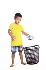 Little boy throwing waste paper