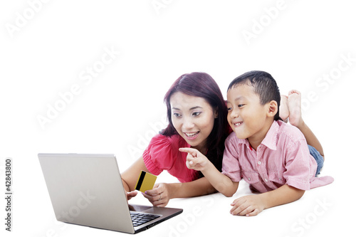 Mother and son shopping online